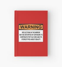 WARNING: REFLECTIONS IN THE MIRROR MAY BE DISTORTED BY EXPOSURE TO CORPORATE POP CULTURE AND ITS STEREOTYPES ABOUT BEAUTY Hardcover Journal