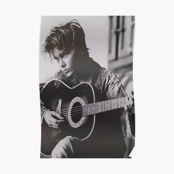 RIVER PHOENIX PLAYING THE GUITAR WITH MELANCOLIC AIR Poster