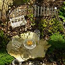 Fairy Garden With White Furniture and Pie by Betty Mackey