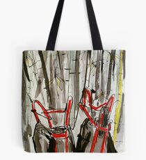 upturned wheel barrows in bamboo clump Tote Bag