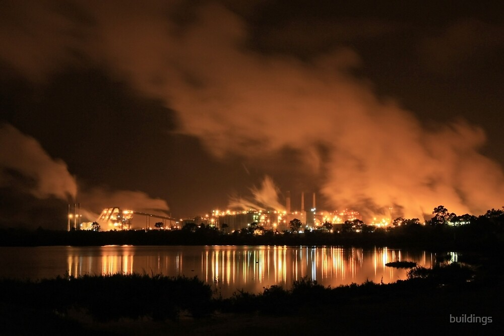 QAL Aluminium Refinery (by night) by buildings
