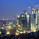 Kota Kasablanka (under construction, at dusk) by buildings