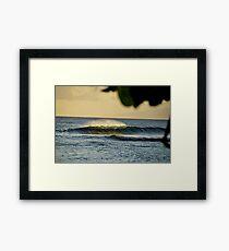 Shinning sunset light through a wave Framed Print