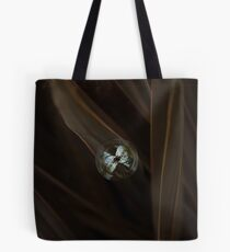Bubble on an orchid leaf Tote Bag