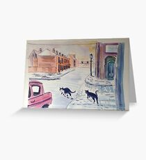 Two cats in a snowy Manchester street Greeting Card