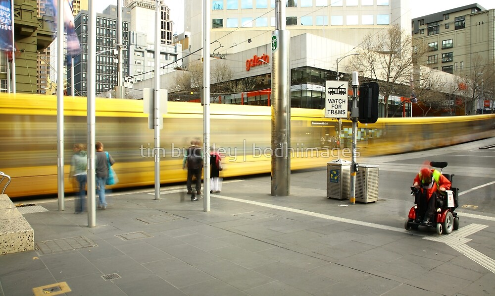 passing trams. melbourne city by tim buckley   bodhiimages