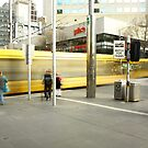 passing trams. melbourne city by tim buckley | bodhiimages