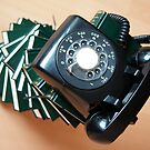 Vintage telephone on top of a stack of books by wildrain