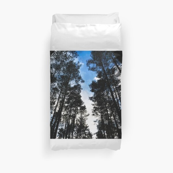 Blue skies and trees at Swinley Forest Duvet Cover