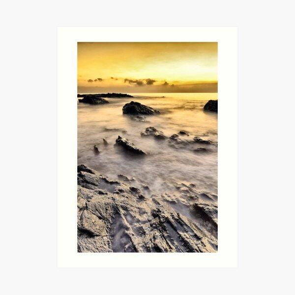 sunrise in a rock beach Art Print