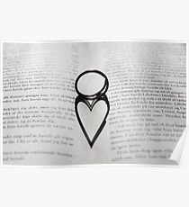Heart shadow with rings on a book Poster