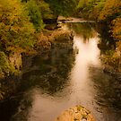 Warm Autmnal Glow over the River Llugwy. Betws Y Coed. by PhillipJones