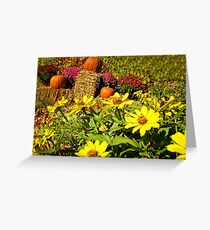 Orange Pumpkins on Hay Bales surrounded by Red Chrysanthemum Flowers & Yellow Daisies Greeting Card