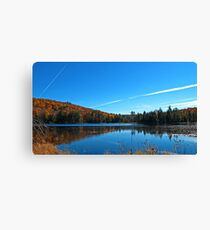 Fall Forest Scene with Orange Leaves - Autumn Lake Reflection under a Blue Sky Canvas Print