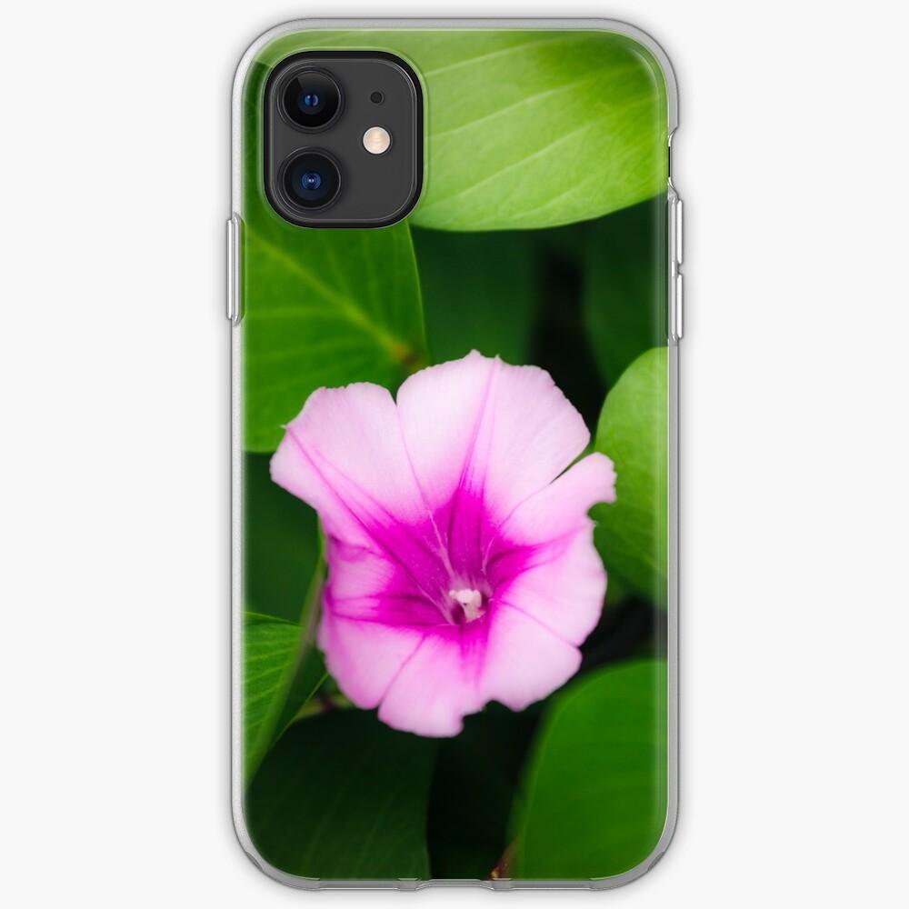 Purple flower between green leaves iPhone Case & Cover