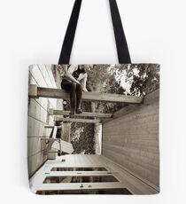 The Tumbling World Tote Bag