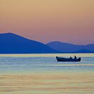 Single Fishing Boat Gliding by the Peloponnese. by Ciaran Sidwell