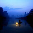 A fisherman on Li River, Guangxi, China   by maysun