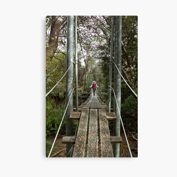 Returing across the rope bridge from Frenchmans Cap, Tasmania Canvas Print
