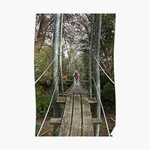 Returing across the rope bridge from Frenchmans Cap, Tasmania Poster