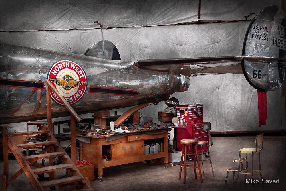 Airplane - The repair hanger  by Michael Savad