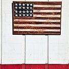 Folk art American flag on wooden wall by Garry Gay