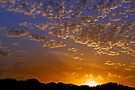 Roiling Sun Sets as Season Turns by Robin Clifton