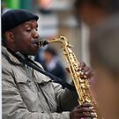 Street Entertainer playing the Saxophone by JoeTravers
