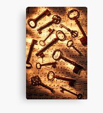 Old skeleton keys on sheet music Canvas Print
