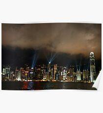 Laser show over city at night, Hong Kong, China. Poster