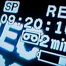 Recording information on television screen, close-up by Sami Sarkis