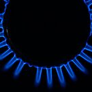 Lit blue gas ring, close-up by Sami Sarkis