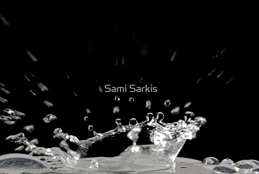 Drop of water splashing, close up by Sami Sarkis