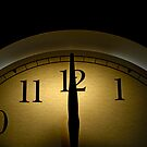 Clock pointing to 12 by Sami Sarkis