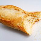 Bitten french baguette by Sami Sarkis