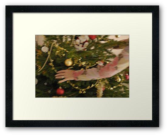 Woman decorating Christmas tree by Sami Sarkis