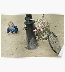 Girl playing with sand near bicycle Poster