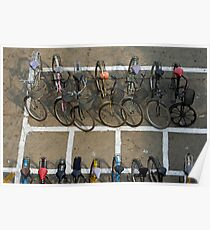 Bicycles parked on street Poster