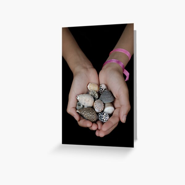 Girl (13-14 years) holding shells in clasped hands Greeting Card