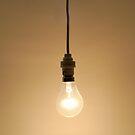 Bare hanging light bulb by Sami Sarkis