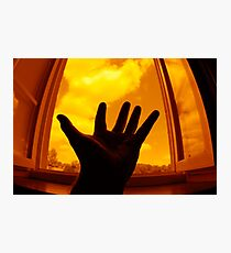 Man with outstretched hand by window Photographic Print