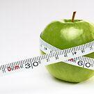 Tape measure round green apple by Sami Sarkis
