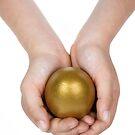 Girl (6-7) holding golden egg by Sami Sarkis