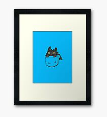 Pocket Toothless Framed Print