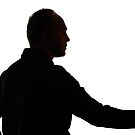 Silhouette of mature man holding rose by Sami Sarkis