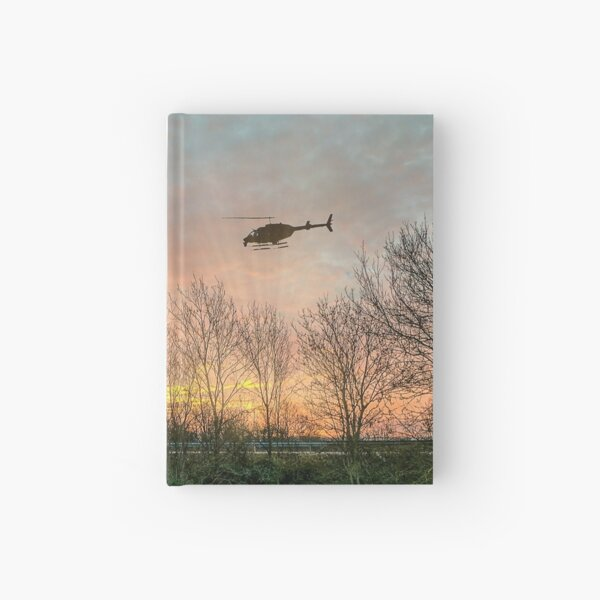 Helicopter flying at night, Stunning Image Hardcover Journal