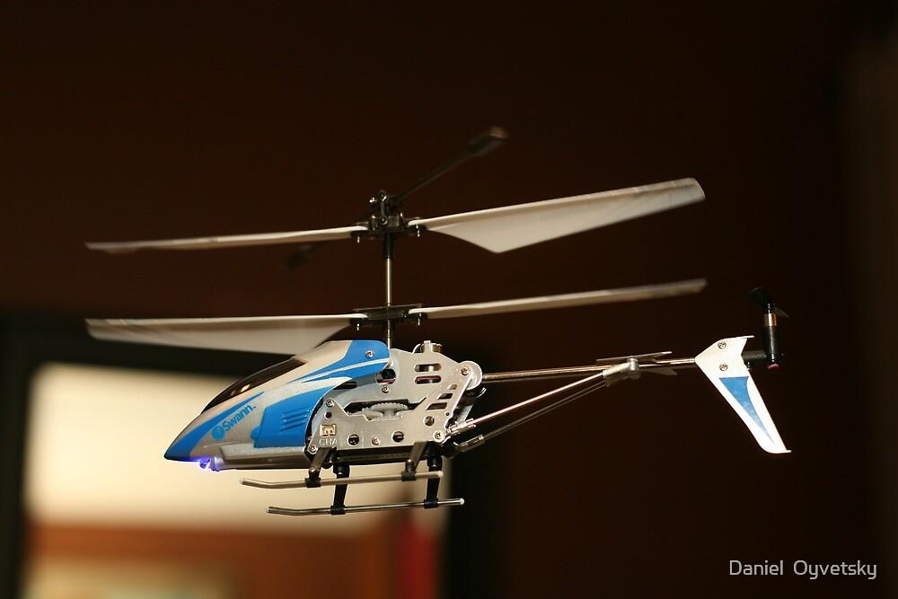 Toy Helicopter - In flight! by Daniel  Oyvetsky