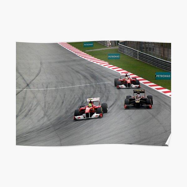 Ferarri's Massa overtakes Lotus Renault's Petrov Poster