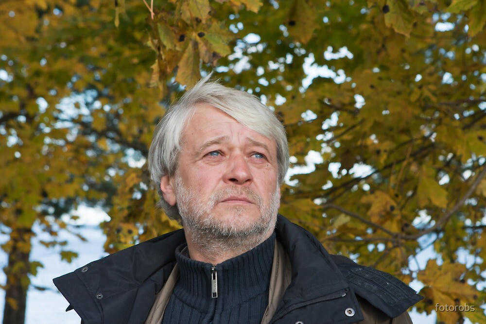 Portrait of middle-aged man in autumn day. by fotorobs