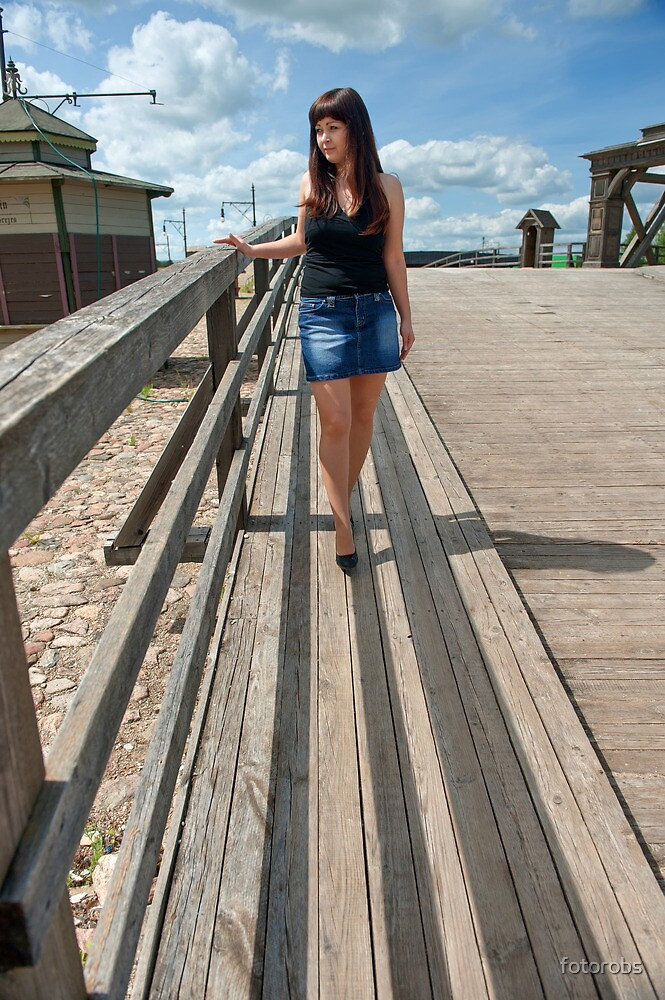 Beauty girl on the old-time bridge. by fotorobs